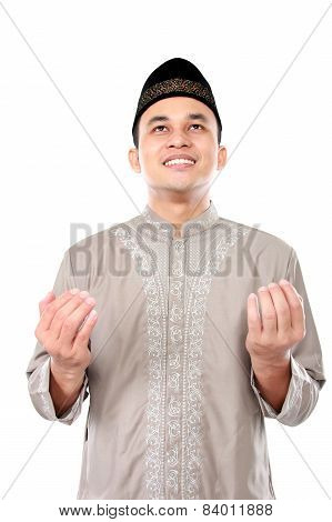 Young Muslim Man Praying To God