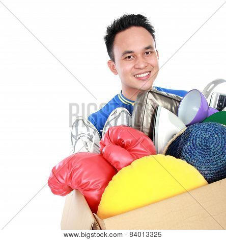 Box Full Of Goodies Carried By Young Man