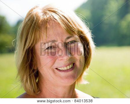 Smiling mature woman outdoor portrait