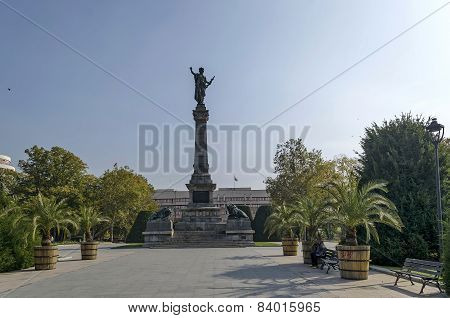 Avenue with palm and monument in Ruse garden
