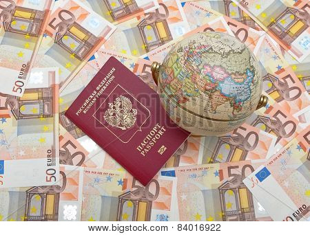 Globe And Passport On A Background Of Euros