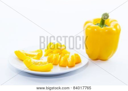 Sliced Yellow Bell Chili Ingredient On White Plate
