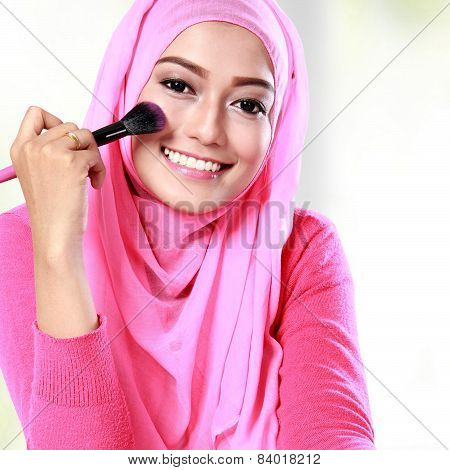 Woman Applying Blush On