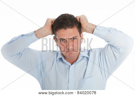 Close Up Angry Businessman Pulling His Hair Out