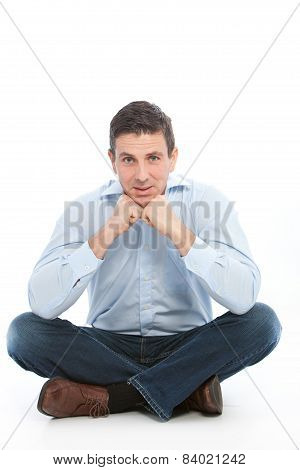Man Sitting On The Floor Leaning On His Fists