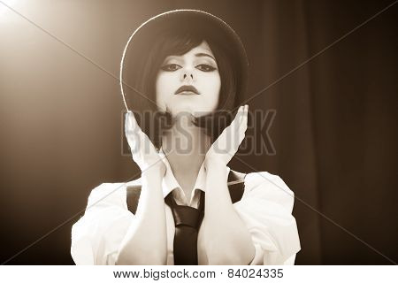 Fashion Brunette Girl In Hat. Studio Shot With Backlight.