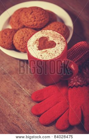 Gloves, Cookie And Cup With Coffee