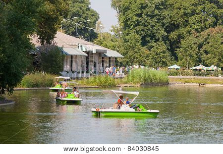 People Riding On Catamarans