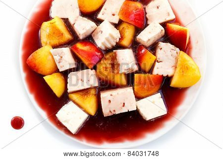 cheese and peaches in red wine sauce, dessert isolated on white