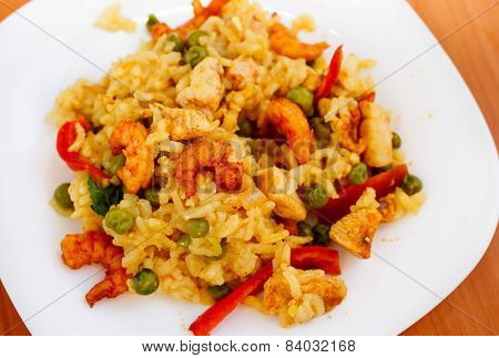 paella with shrimps on white plate