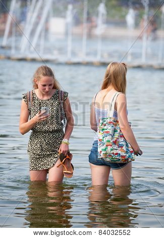 Two Girls Standing In Water