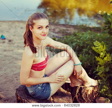 young blond woman at nature, toned effect