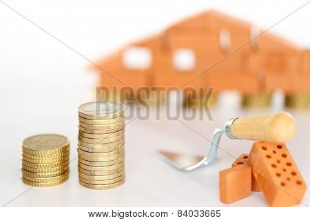 Coins And Bricklayer Tools