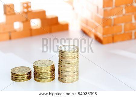 Coins And Brick Wall