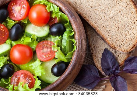 Spring Super Food Vegetarian Salad With Tomato And Olives On Rustic Background Top View