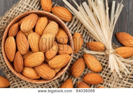 Almonds Super Food In A Wooden Dish On Vintage Textile Background With Retro Toning