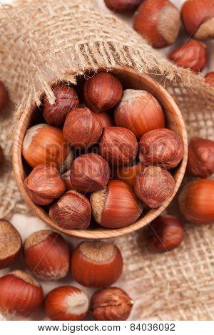 Hazelnut Superfoods In Wooden Dish On Vintage Textile