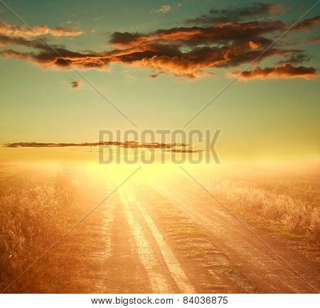 Colorful Sunset Over Country Road On The Background Of Dramatic Sky