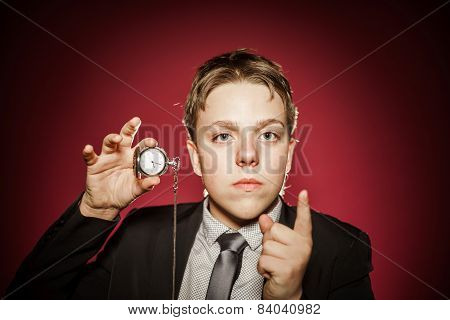 Affective Teenage Boy With Watch Showing Time