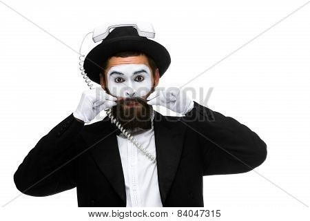 man in the image mime holding a handset.