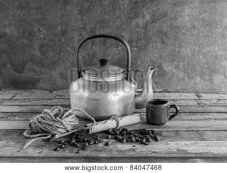 Old Kettle,paper Roll,rope Reel And Coffee Beans On Wooden Background