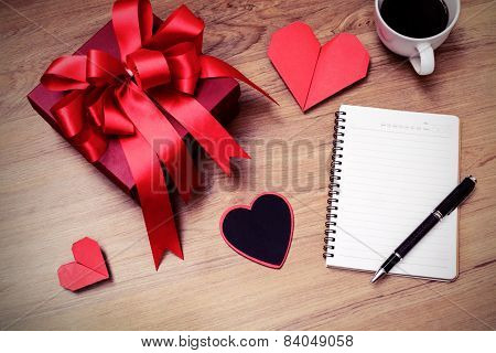 Blank Notepad With Copy Space And Red Gift Box