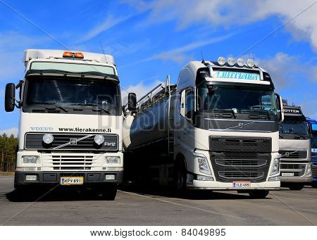 Different Generations of Volvo FH Trucks Parked In A Row