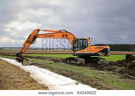 Hyundai Robex 210LC-9 Crawler Excavator On A Field At Spring
