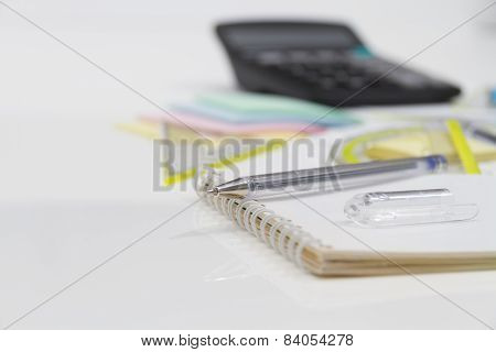 Drawing Tools with pen, notebook and calculator.