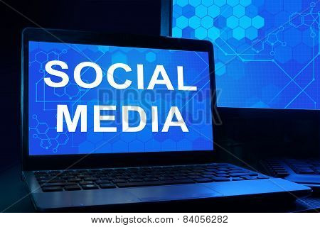 Computer with words Social Media.