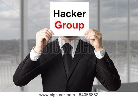 Businessman Hiding Face Behind Sign Hacker Group