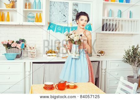 Girl Apron With Flowers In The Kitchen.