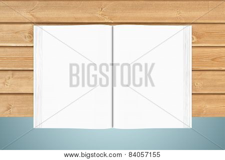 White blank open book on wooden planks