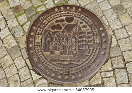 Exterior of the decorated sewer manhole in Bergen, Norway.