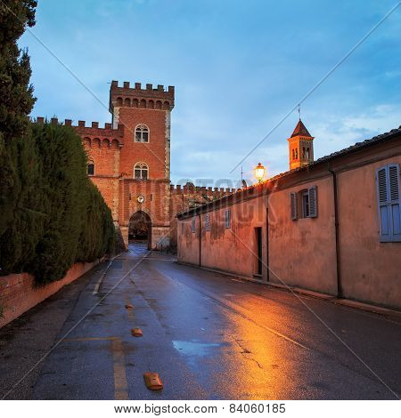Bolgheri Medieval Village Entrance And Tower On Sunset. Maremma, Tuscany, Italy