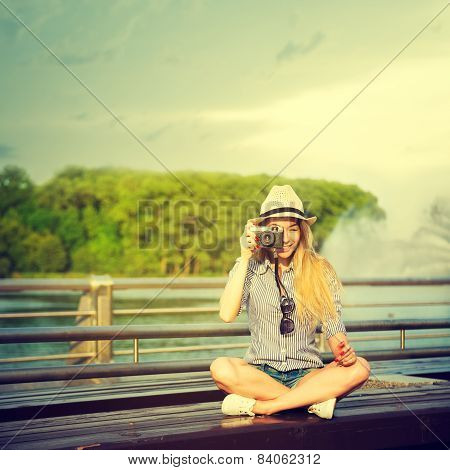 Portrait of Young Hipster Girl Making Photo
