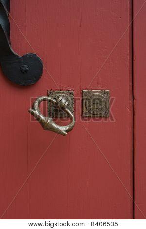 Red door with brass handle