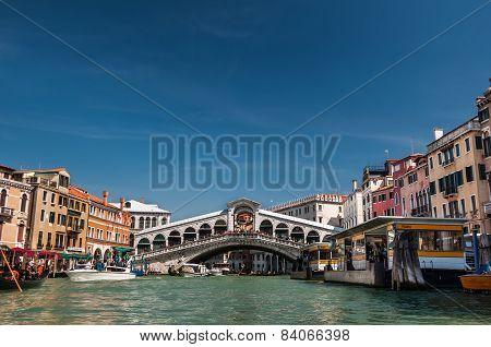 Rialto Bridge And Boats On Grand Canal, Venice, Italy