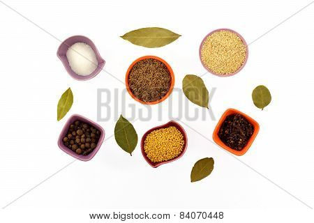 Various Kinds Of Spices In Tiny Cups