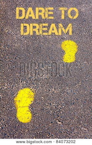 Yellow Footsteps On Sidewalk Towards Dare To Dream Message