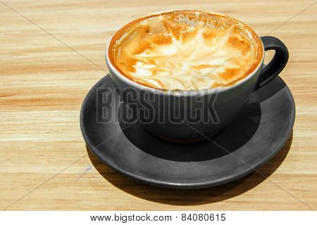 Capuccino Coffee On Wood Table