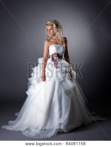Majestic bride posing in lush wedding dress