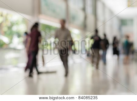 Blurred People Walking In The Building