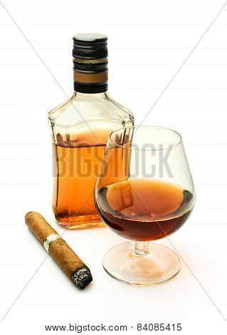 Brandy In A Glass And A Bottle With A Cigar