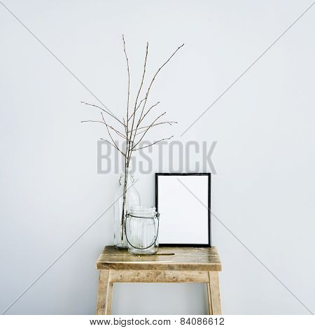 Black Frame With Place For Text  With Glass Bottles. Scandinavian Hipster Style Room Interior