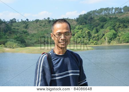 Thin Asian Man Wearing Eyes Glass With Skin Head Hair Fashion Smiling To Camera
