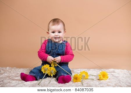 Smiling Infant Baby With Yellow Flowers