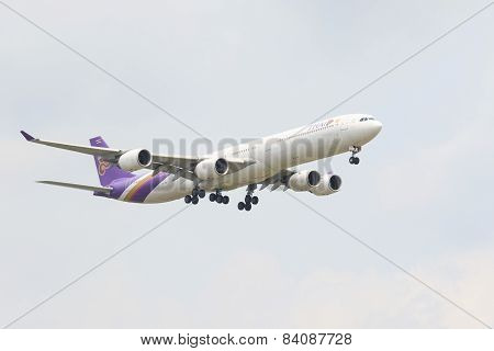 Thailand,bangkok-mar 3:thai Airways Plane Flying Above Suvarnabhumi Airport Runway And Prepare To La