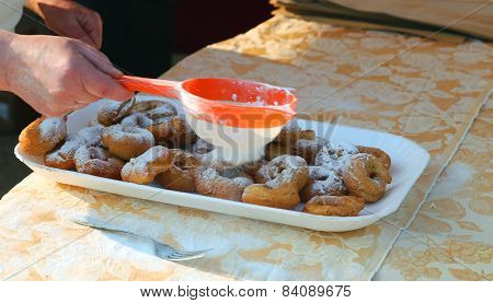 Elder Cook Spread The Icing Sugar Over Cooked Doughnuts