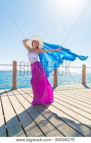 Beautiful woman wearing hat and pink skirt